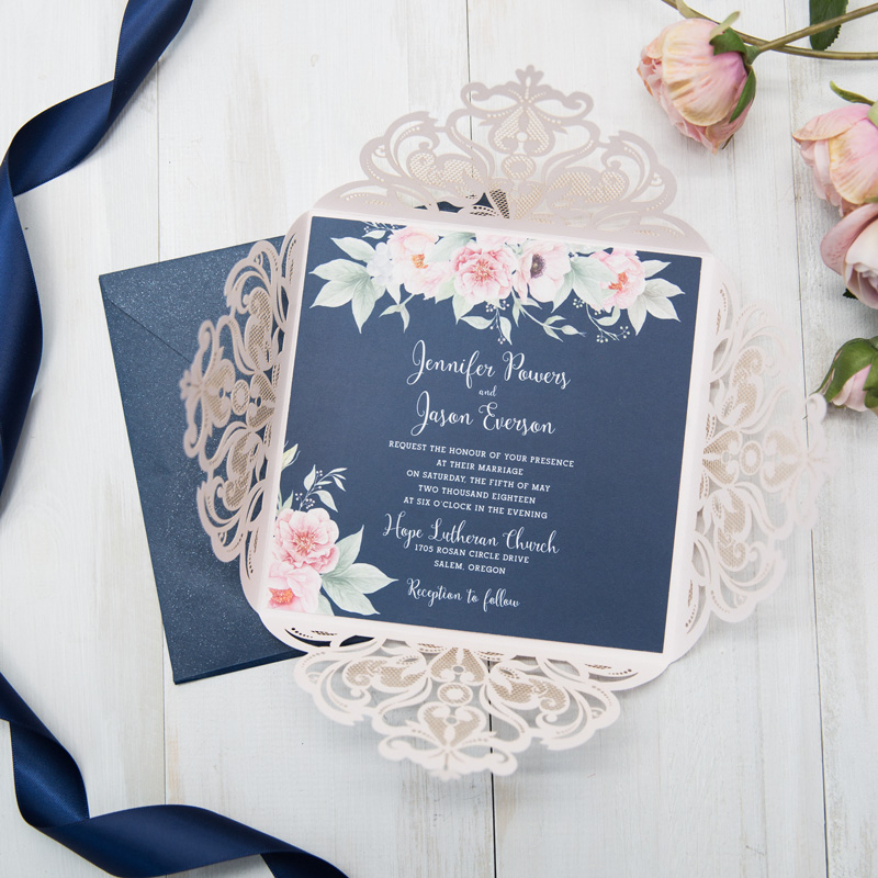 beautiful navy and blush pink laser cut wedding invites