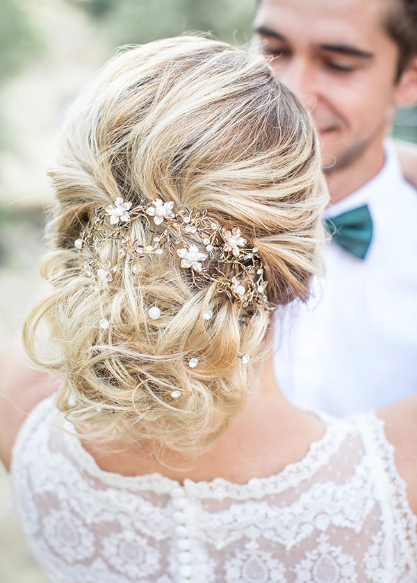 Messy Updo Bun Adorned with Soft Floral Rose Gold and Crystal Vine Accessory