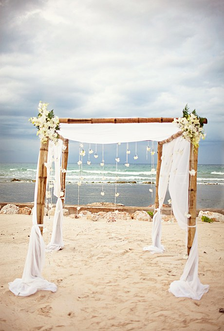Bamboo Beach Wedding Arbor With Dripping White Flowers
