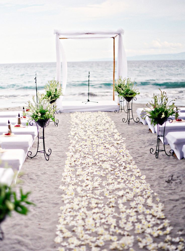 Beach Wedding Aisle Paved with White Flowers