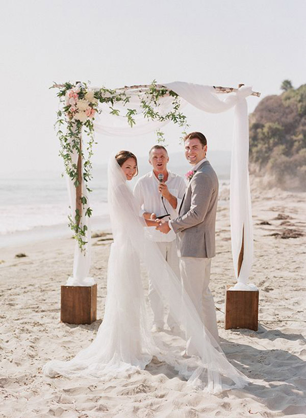 Beach Wedding Arch Ideas with Flowers and White Fabric