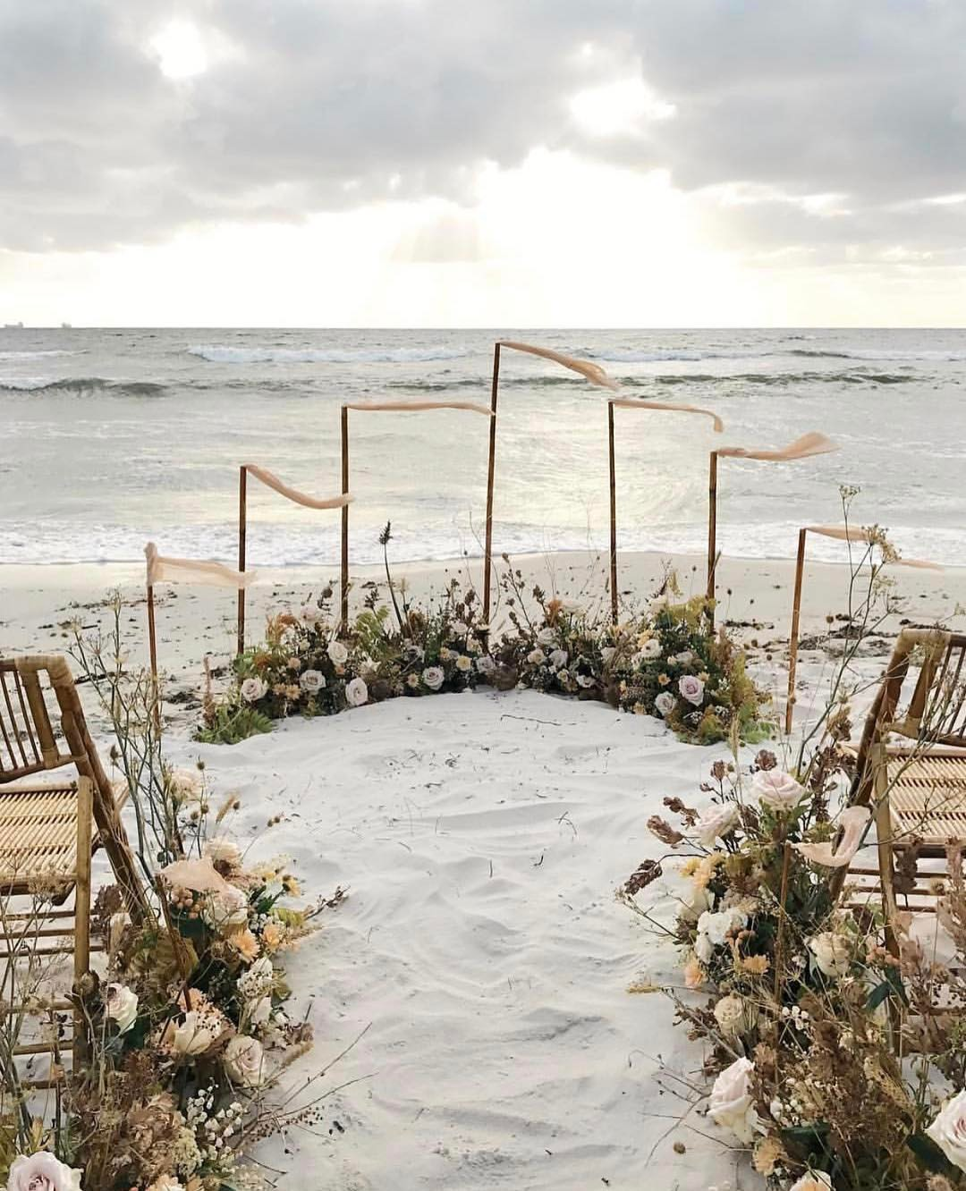 Breathtaking Beachfront Wedding Ceremony at Sunset