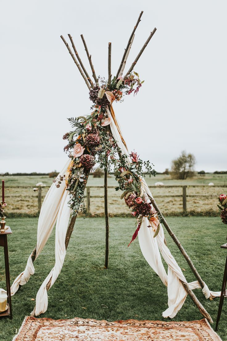 Chic boho wedding arch ideas with lush florals