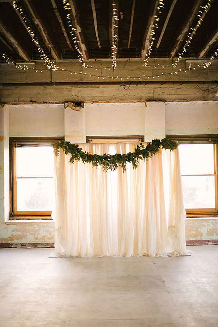Green garland and white drapery wedding backdrop ideas