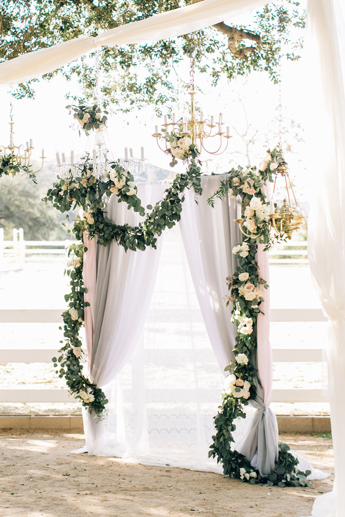 Hanging floral garland wedding ceremony backdrop
