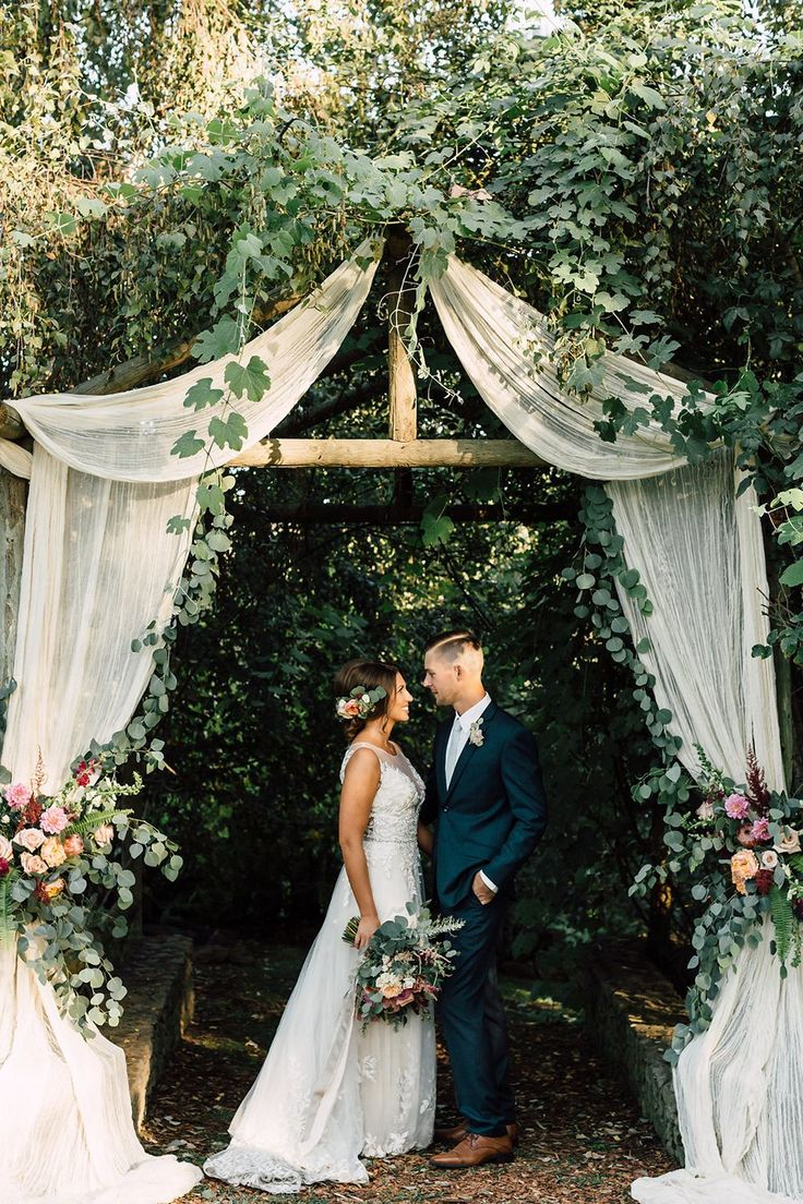 Romantic wedding arch ideas with fabric and eucalyptus
