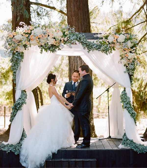 Sweet Peach floral and drapery wedding arch
