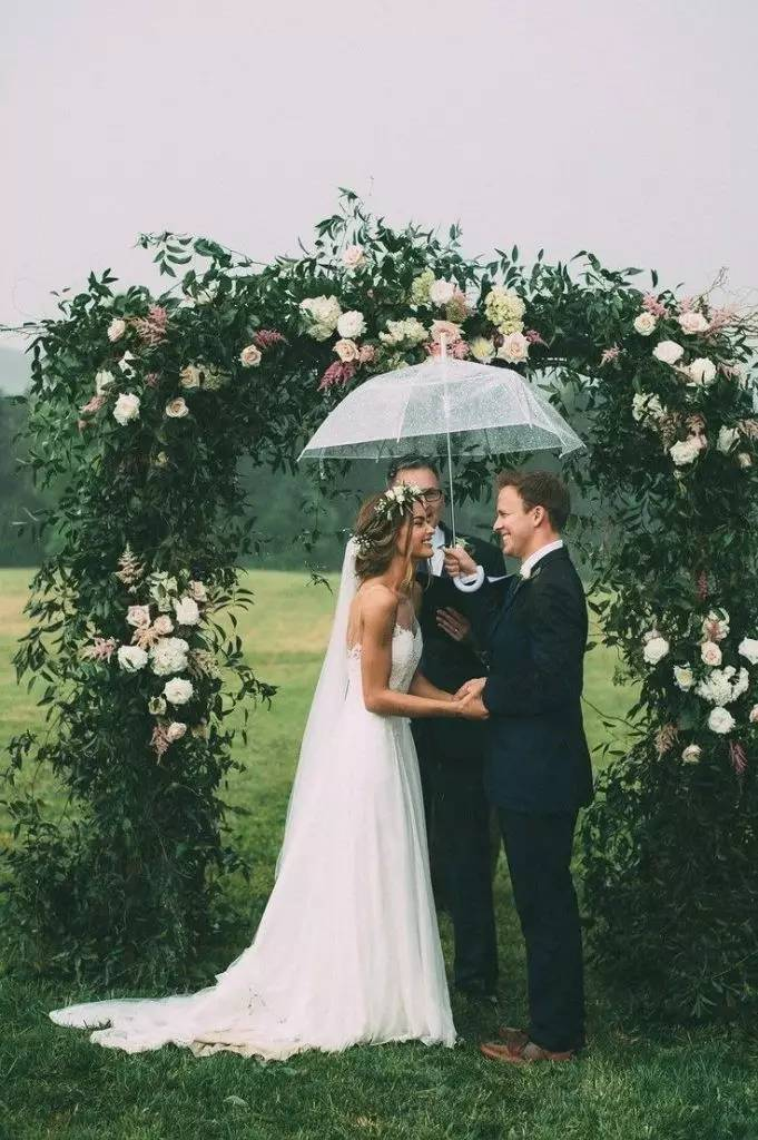 What a romantic rainy day wedding ceremony photo