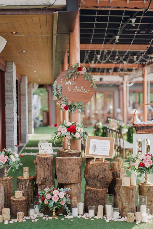 Creative romantic wedding decoration with stumps, florals and candles