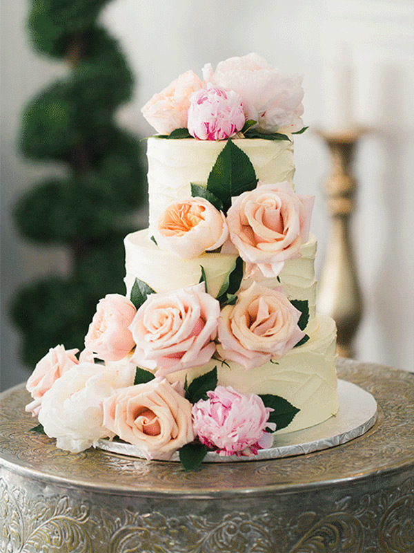 Romantic Floral Spring Wedding Cake filled with Soft Pink Peach Peonies and English Garden Roses