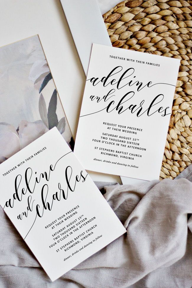 Simple white calligraphy wedding invitations