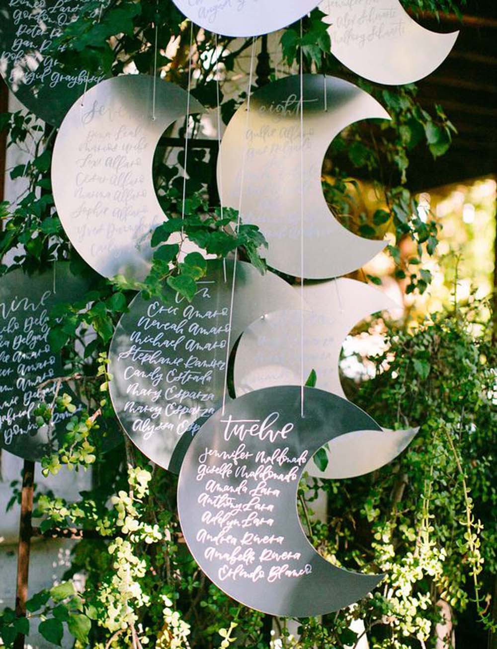 Unique moon-shaped seating plan display ideas.