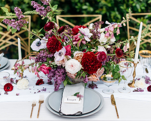 Wild Rich Blooms Spring Wedding Centerpiece with Gold Details