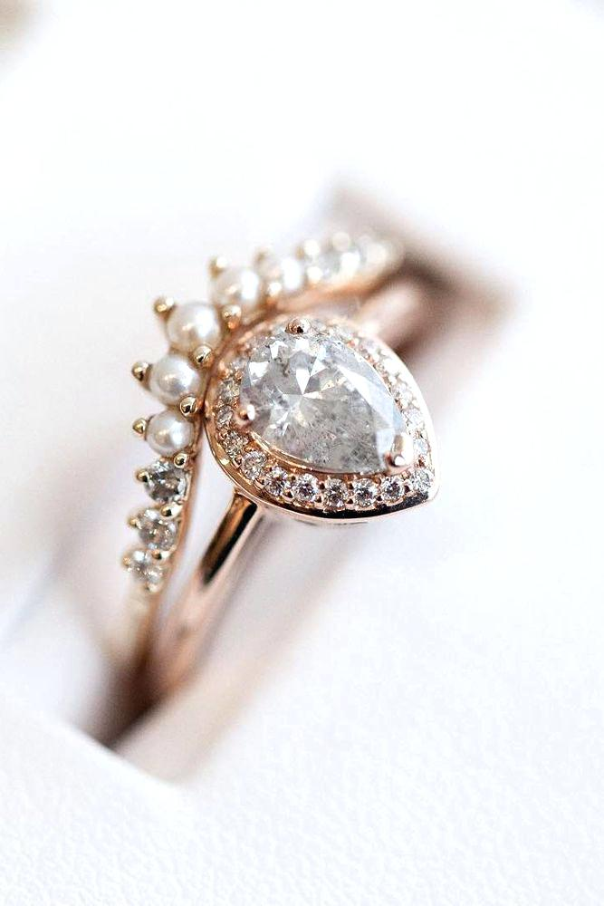 antique shaped pearl and diamond engagement ring