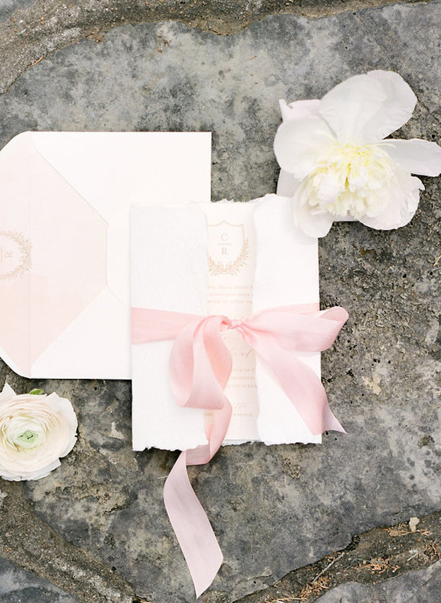 simple and elegant folded wedding invitation with pastel long ribbon