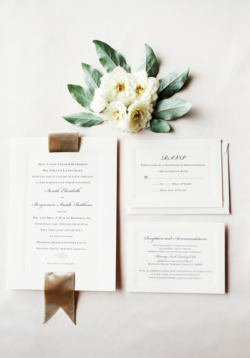 simple white wedding invitation card with fabric accent