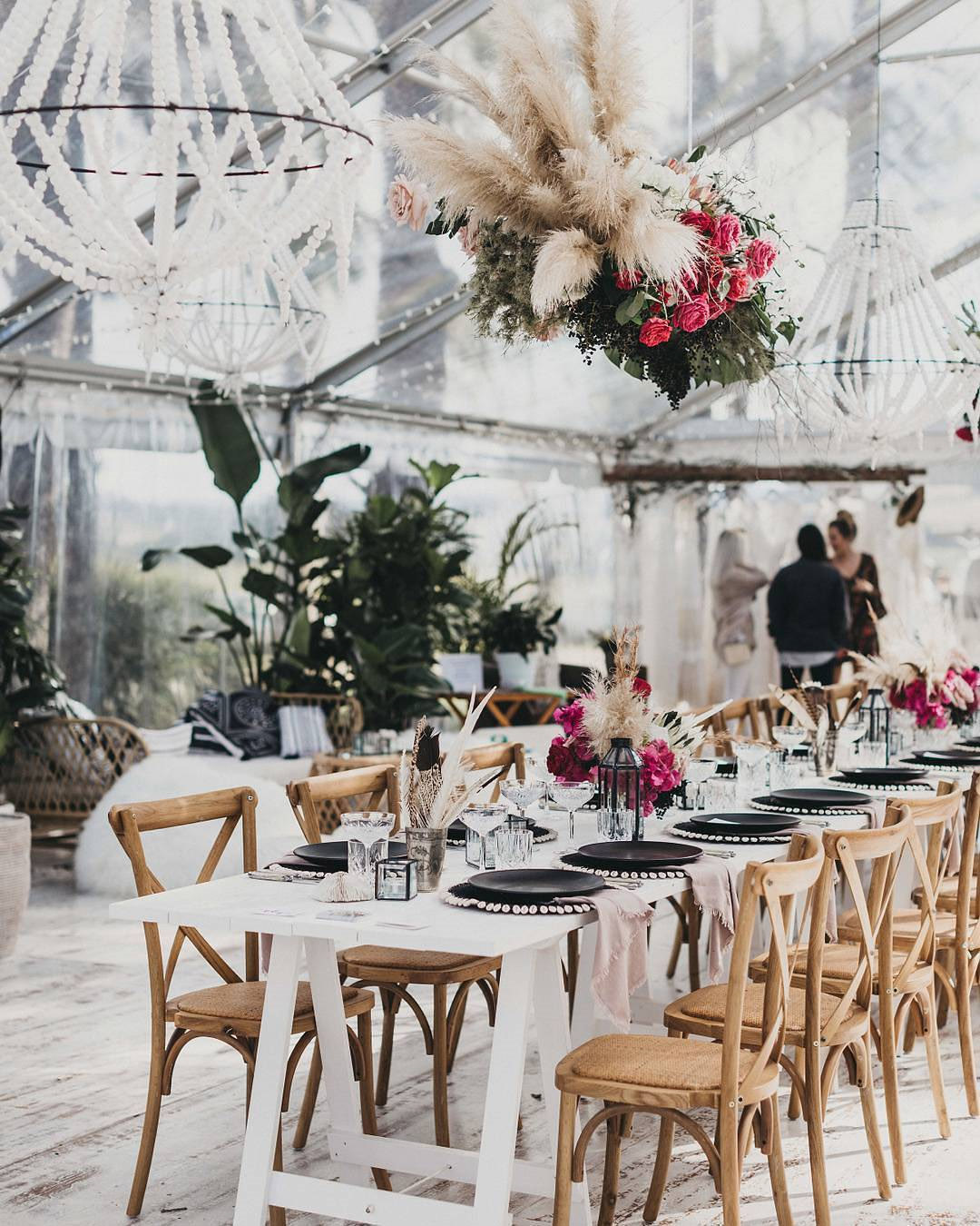 glam indoor wedding reception with hanging pampas grass