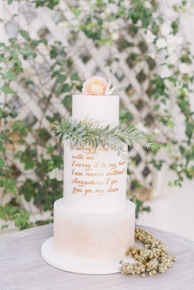 hand lettered love quote watercolor blush and gold wedding cake