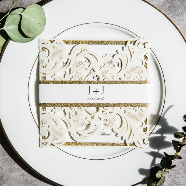 ivory laser cut wedding invitations with glittery band