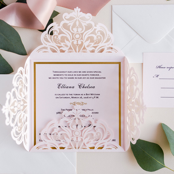 blush pink laser cut wedding invitation with glitter accents