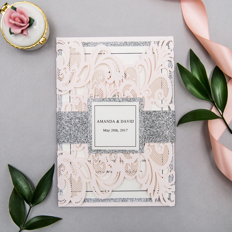 elegant blush wedding invitation with silver belly band and tag