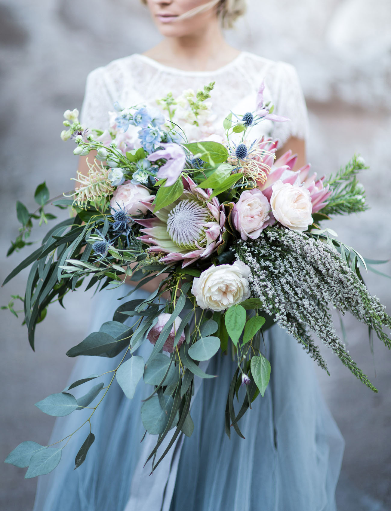 gorgeous relaxed blue and pink flower bridal bouquet with lots of greenery