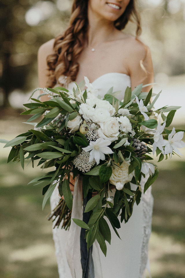 greenery and white bridal bouquet with ribbon bows