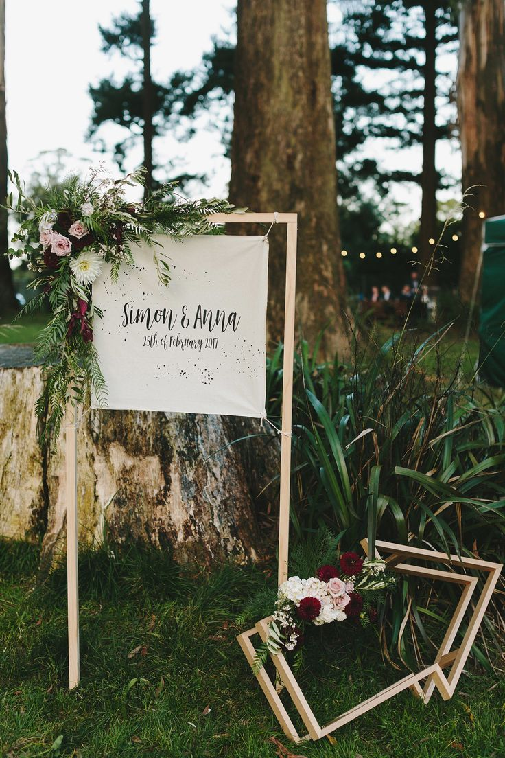 Fun floral wedding signage with timber arrow