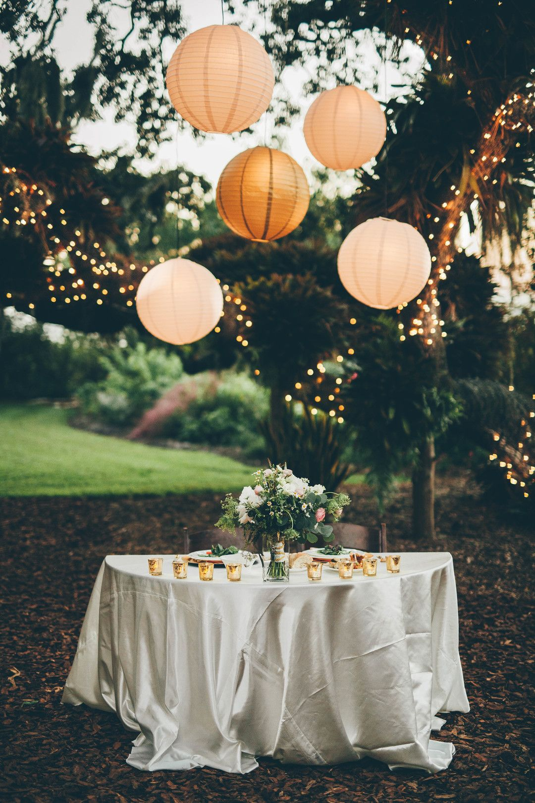 Wedding reception lighting design with paper lantern and stringlights