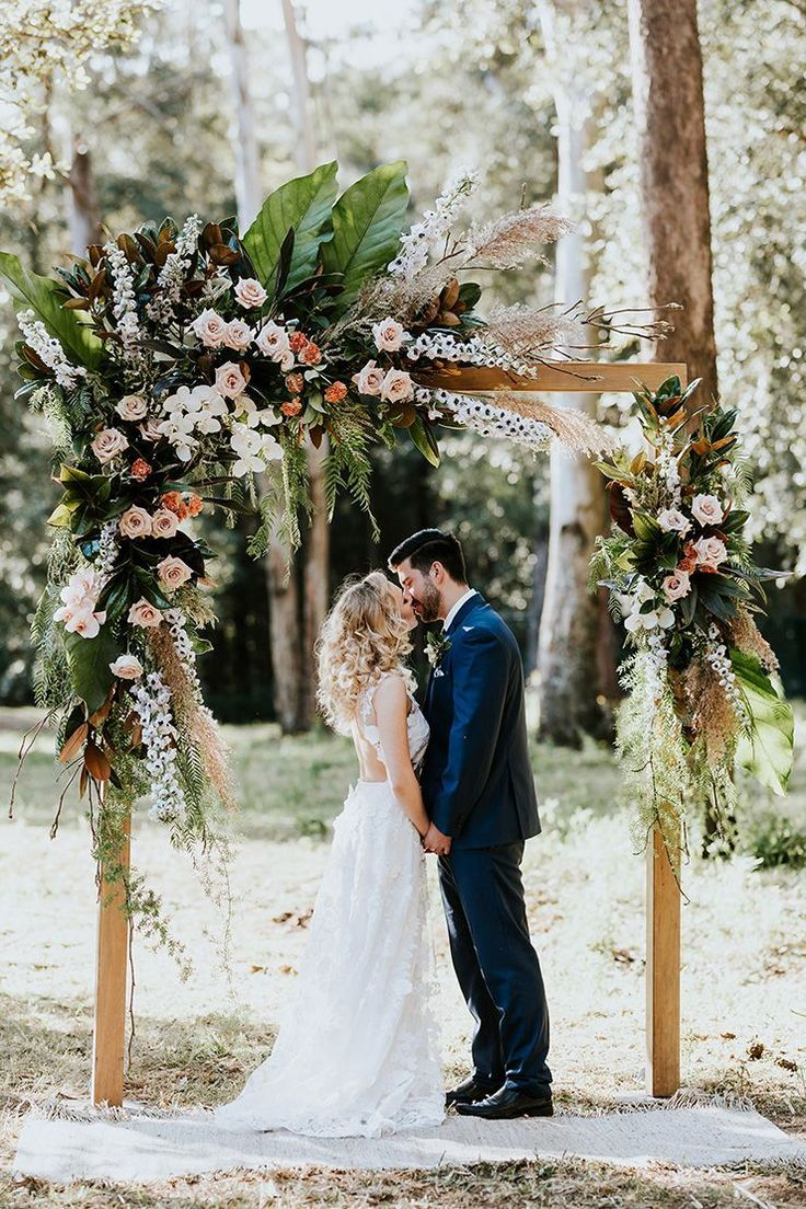 boho woodland wedding ceremony floral arbour