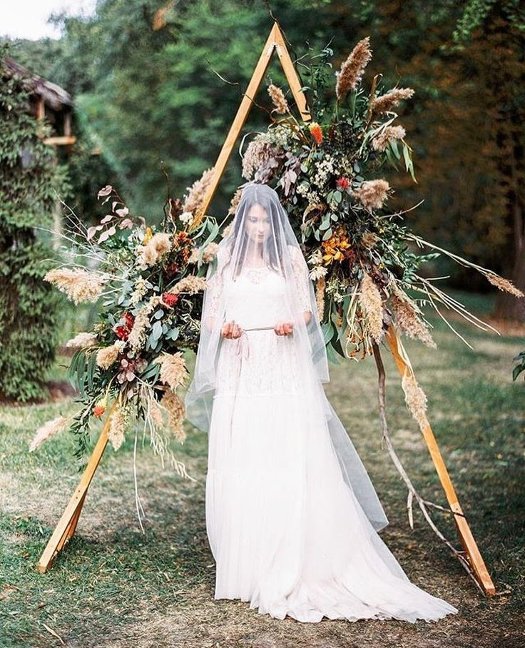 geometric wedding arch with floral for boho weddings