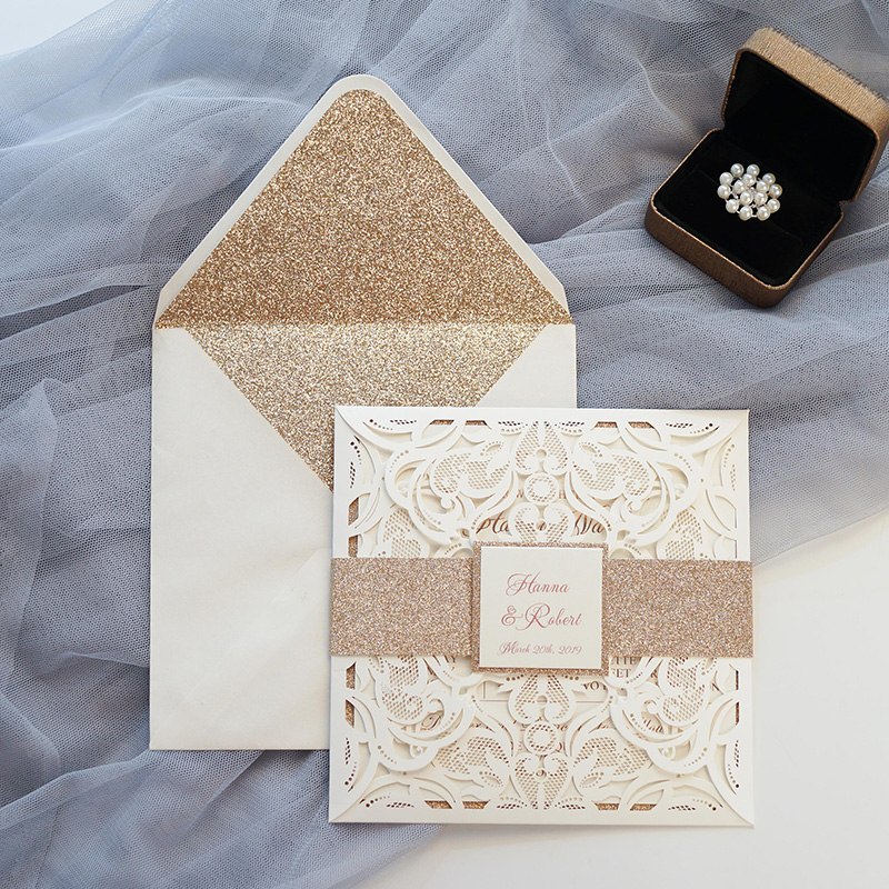rose gold laser cut wedding invites with glittery belly band