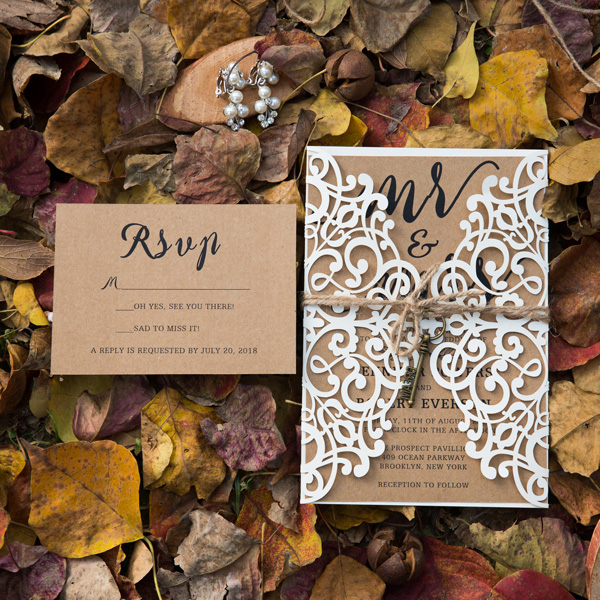 rustic laser cut wedding invitation set with twines and key
