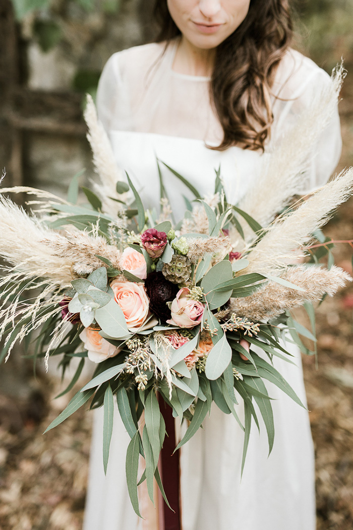 trendy flowers bridal bouquet wuth peach rose and pampas grass