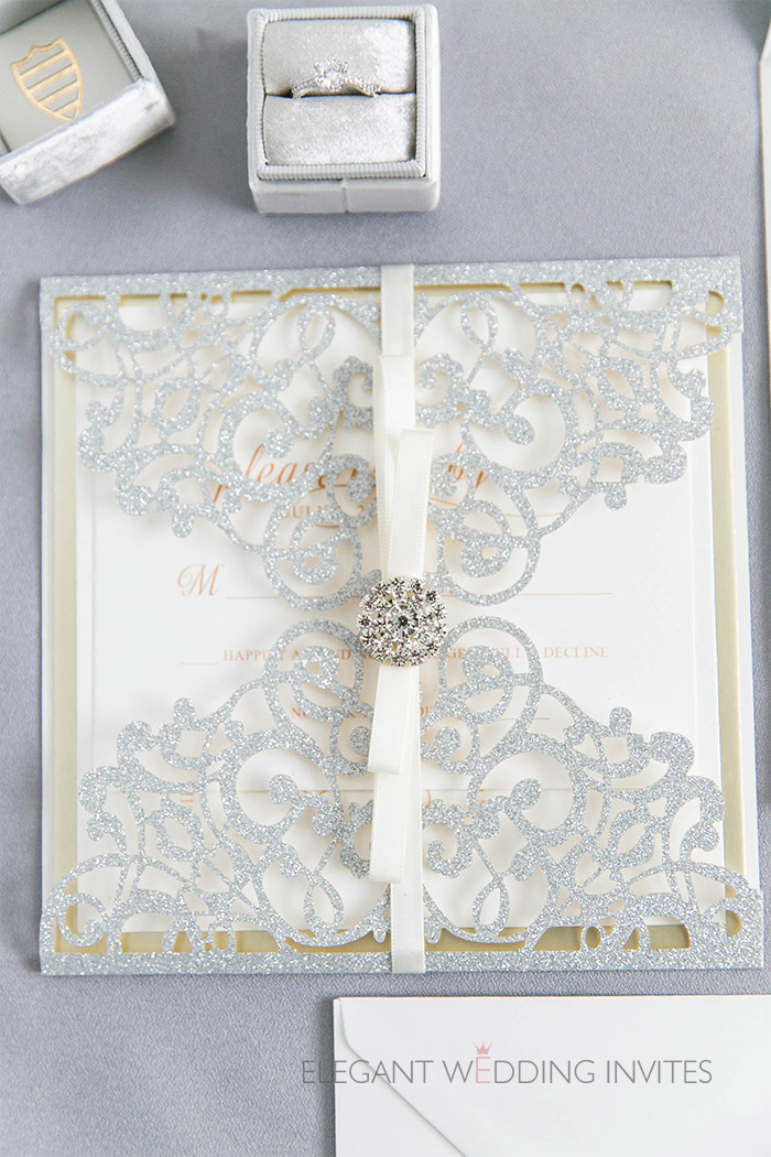 elegant silver glitter and champange shade laser cut wedding invites