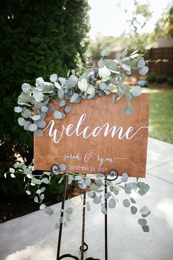 greenery garland decorated wedding sign board