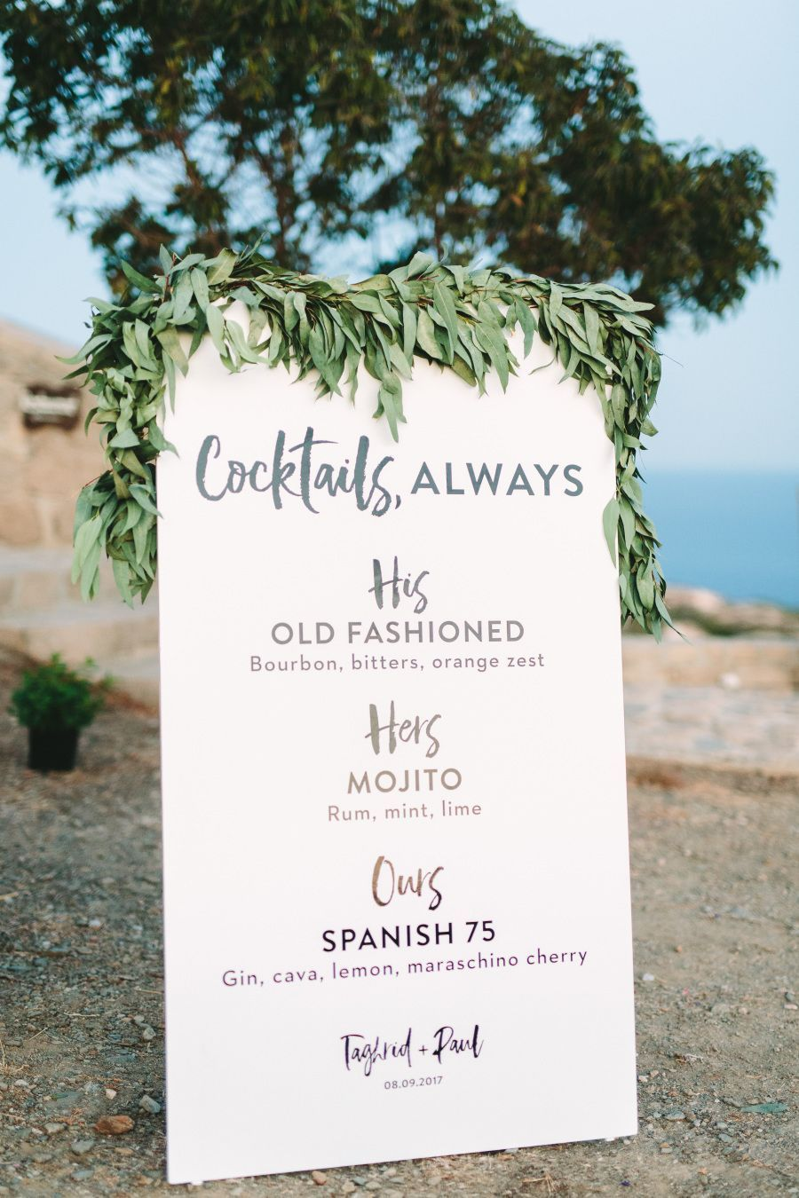 simple white and greenery signature drink wedding signs