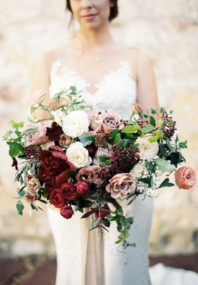 gorgeous fall wedding bouquet with deep red peonies and pinky brown roses
