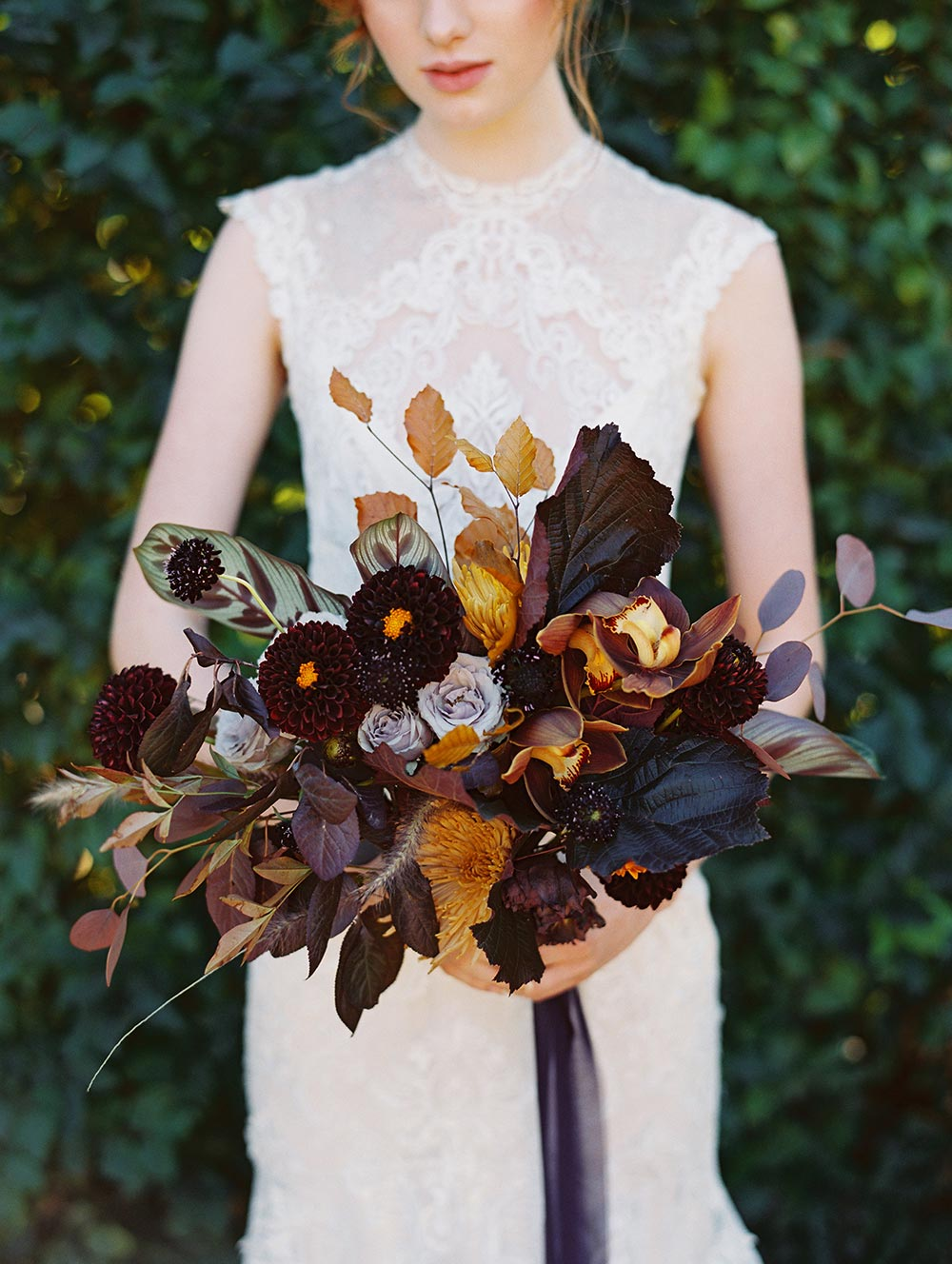 moody apricot and terra cotta with forest green and maroon wedding bouquets