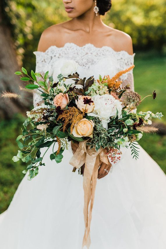 mustard yellow, peach and greenery fall wedding bouquet with dark red flowers