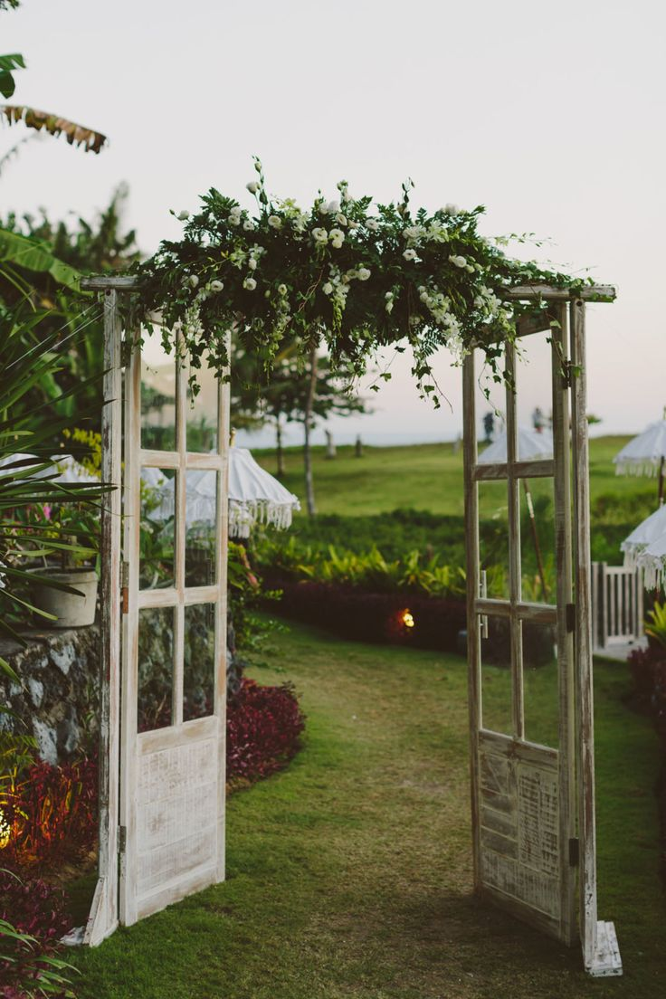 old door wedding backdrop with greenery for vintage weddings