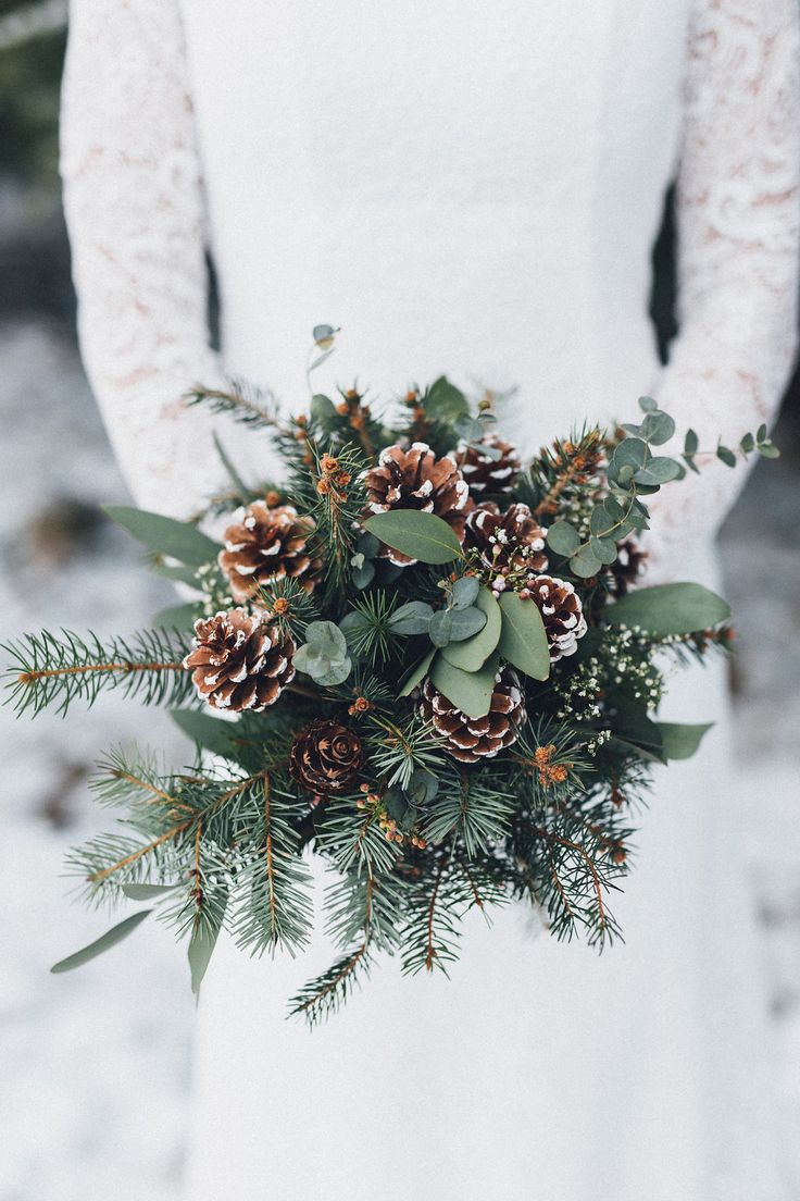 pine cone and greenery winter wedding bouquets