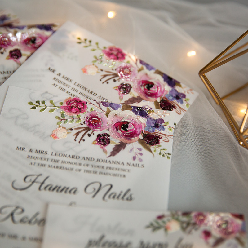 translucent vellum wedding invitation with raised flower pattern