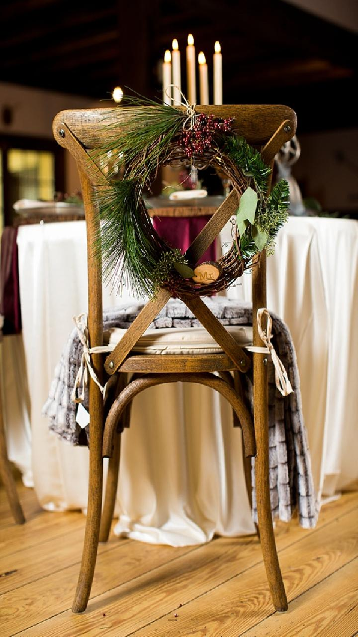 vine and evergreen wreath chair decoration for winter christmas wedding