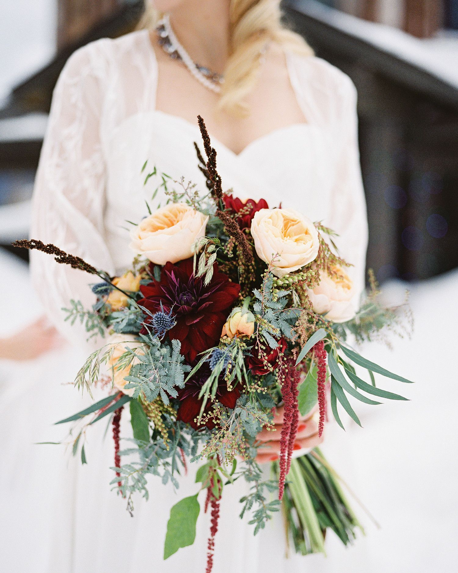 winter wedding bouquets ideas with greenery, ranunculus, hanging amaranthus, and roses