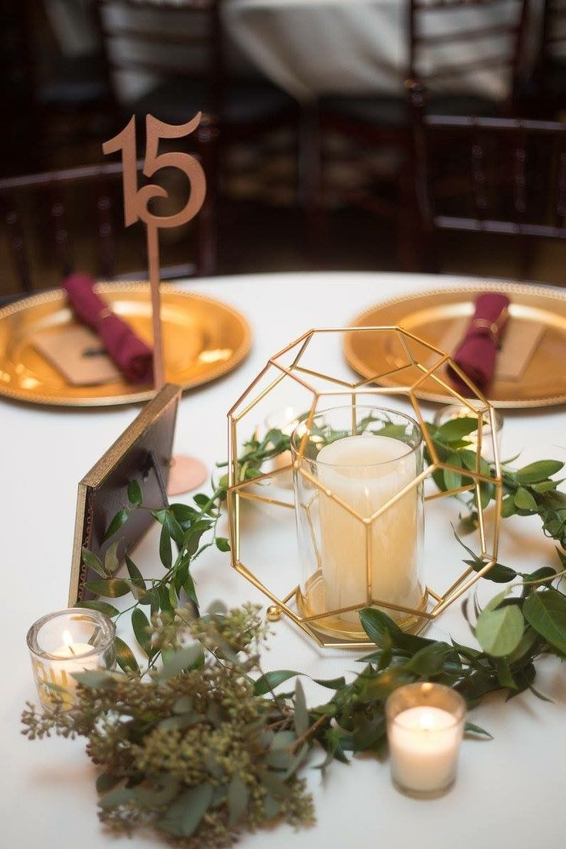 Geometric metallic and greenery wedding table centerpieces