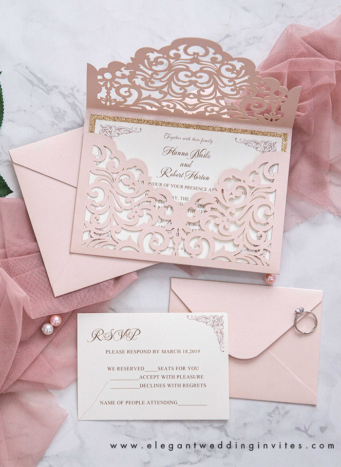 blush pink laser cut wedding invites with rose gold glitters