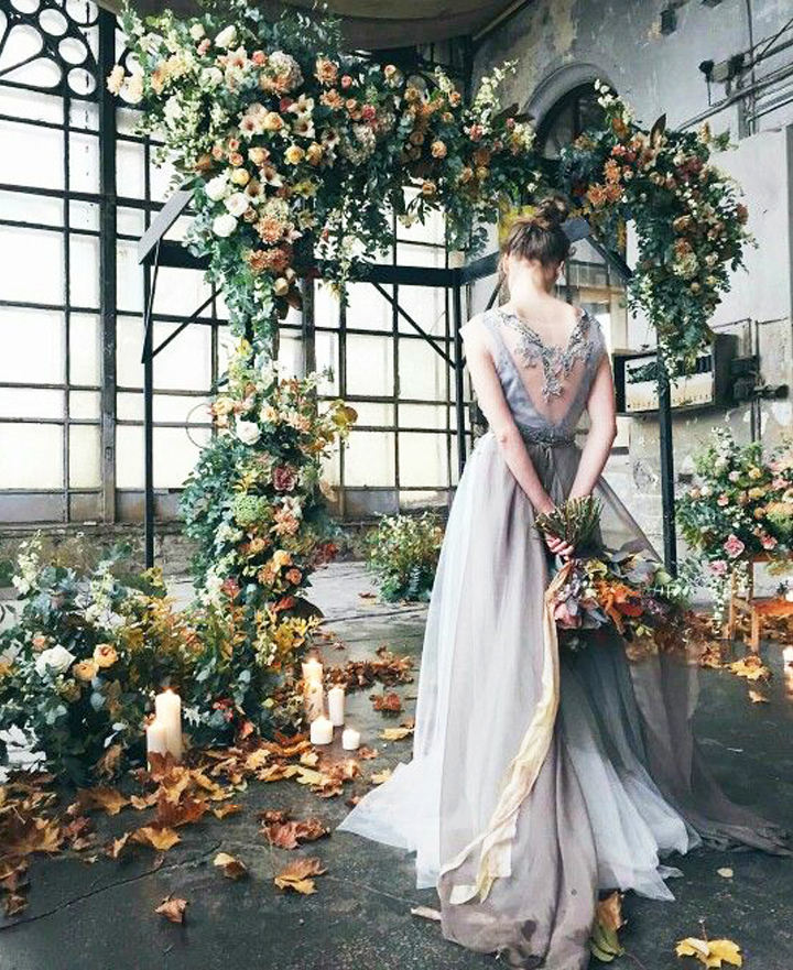 fall-inspired wild floral arch with greenery and fall leaves