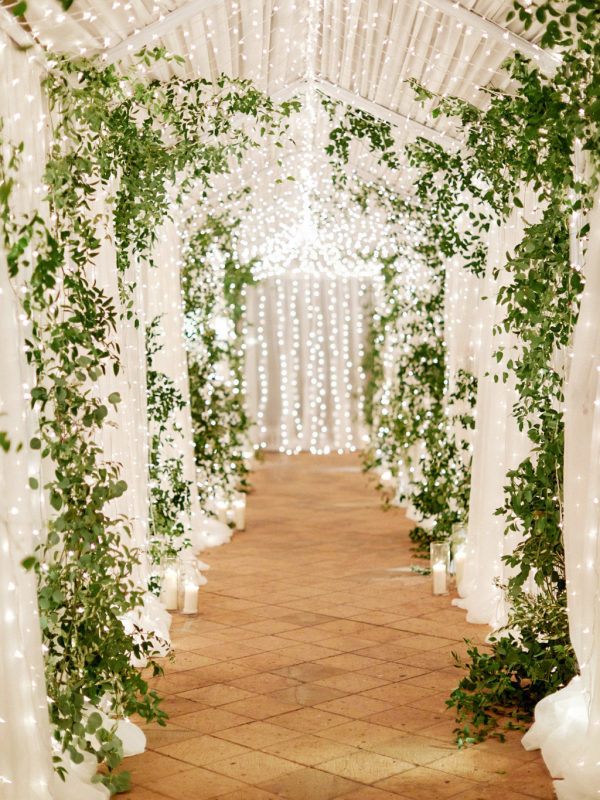 romantice wedding ceremony entrance decoration with hanging string lights