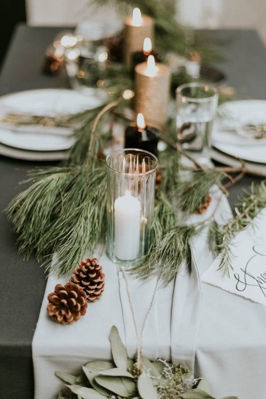 stunning winter wedding table settings with pincones and evergreen